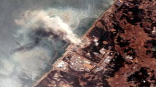 In this satellite view, the Fukushima Dai-ichi Nuclear Power plant after the massive earthquake and subsequent tsunami.