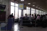 Passengers line up for flights out of Bahrain at the country's airport March 17.