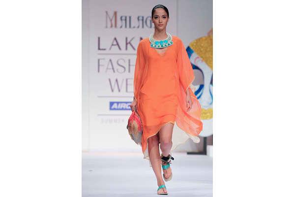 MUMBAI, INDIA - MARCH 13: A model walks the runway at the Malini Agarwalla show at Lakme Fashion Week Summer/ Resort 2011 day 3 at the Grand Hyatt on March 13, 2011 in Mumbai, India. (Photo by Chirag Wakaskar/WireImage)