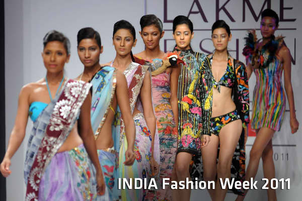 Models display creations during the Gennext Designers show at the opening of the Summer Resort 2011 Lakme Fashion Week in Mumbai on March 11, 2011. AFP PHOTO/STR (Photo credit should read STRDEL/AFP/Getty Images)