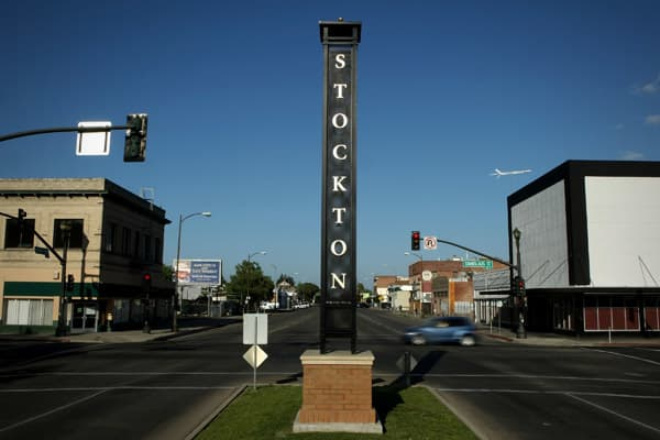 "Stockton is one of those hard-hit California cities that has yet to show signs of stabilizing or recovery. Unemployment remains high at 18 percent, and it's one of the worst cities for foreclosures, according to RealtyTrac, with 1 in 14 homeowners facing foreclosure. Its struggles have resulted in high crime and obesity rates. ""Declining housing prices mean new affordability, which is difficult to find on the West coast and California especially,"" Sperling said. Plus, it's got a mild Mediterran"