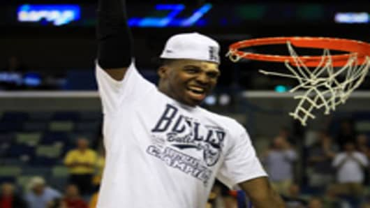 Shelvin Mack #1 of the Butler Bulldogs celebrates defeating the Florida Gators 74 to 71 in overtime