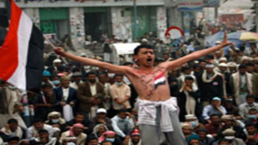 Yemenis take part in an anti-government demonstration against President Ali Abdullah Saleh