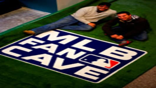 Ryan Wagner (left) and Mike O'Hara (Right) get used to their Fancave created by Major League Baseball.