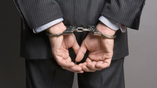 businessman_handcuffs_200.jpg