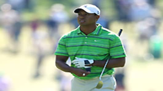 Tiger Woods walks up the first hole during the first round of the 2011 Masters Tournament at Augusta National Golf Club on April 7, 2011 in Augusta, Georgia.