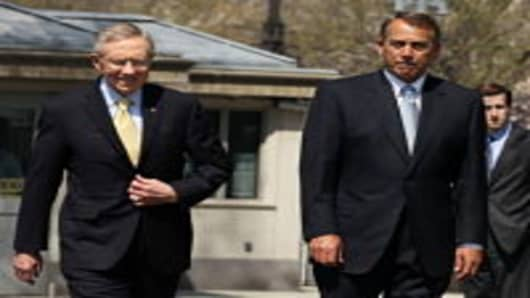 U.S. Senate Majority Leader Sen. Harry Reid and Speaker of the House Rep. John Boehner.