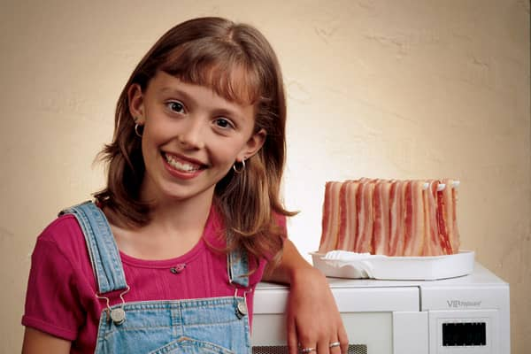 "One Saturday morning in 1991, eight-year old Abbey Fleck was making bacon with her dad. They'd run out of paper towels, so he put it on the classified section of the newspaper. Mom wasn't too pleased, prompting dad to growl, ""I could just stand here and let it drip dry.""Ding! Young Abbey thought if they could make a rack to hang the bacon, with a dish underneath, they'd never need paper towels. And so, the for cooking bacon in the microwave was born. Not only does it save on paper towels, it's h"