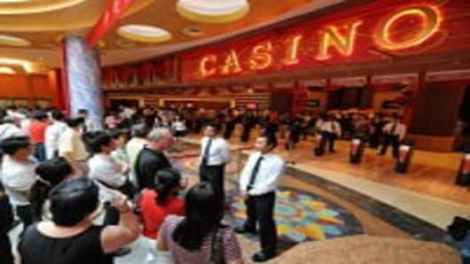 Visitors wait to enter Singapore's first casino at the Resorts World Sentosa complex in Singapore on February 14, 2010. Singapore's first casino opened for business when the first punter was allowed into the gaming section of the Sentosa complex. The opening -- to be followed within months by a second casino resort -- is part of a multi-billion-dollar effort to transform Singapore's tourism industry.