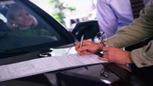 car_hood_signing_paperwork_200.jpg
