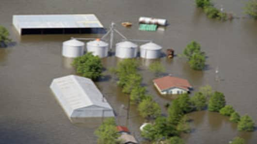 Floodwater engulfs a farm in Missouri