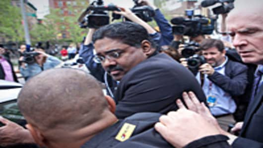 Raj Rajaratnam, confronted by media as he leaves the Daniel Patrick Moynihan United States Court House at 500 Pearl Street after being found guilty of 14 charges against him on May 11, 2011 in New York City. After eleven days of deliberation a jury convicted Rajaratnam with all 14 counts of securities fraud and conspiracy.