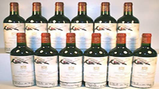 Lot #450 Est. Price $3,200-3,800 - Château Mouton-Rothschild (1996) 12 bottles