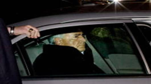 International Monetary Fund chief, Dominique Strauss-Kahn, is placed in the backseat of a police vehicle outside of a New York City Police Department facility in New York City.