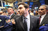 Linkedin CEO Jeff Weiner (C) walks to the trading post after the ringing of the opening bell of the New York Stock Exchange May 19, 2011 during the initial public offering of the company.