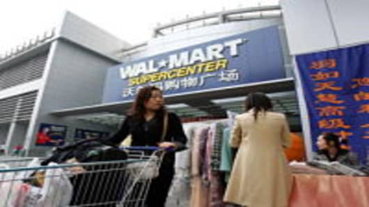 A Chinese customer leaves after shopping at Beijing's first Wal-Mart supercenter October 14, 2006 in Beijing, China. Wal-Mart workers in China have set up unions at all 62 Chinese outlets in what a senior Chinese trad