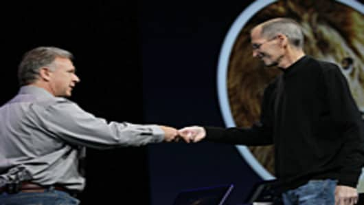 Apple CEO Steve Jobs bumps fists and hands the stage over to Senior Vice President of Worldwide product marketing Phil Schiller.