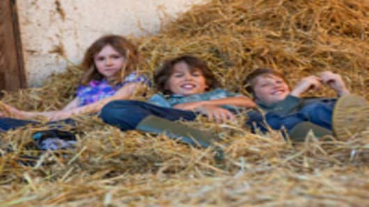 kids_laying_hay_barn_200.jpg