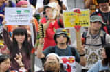 People march on the street during an anti nuclear demonstration in Tokyo on June 11, 2011.