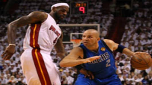 Jason Kidd #2 of the Dallas Mavericks drives against LeBron James #6 of the Miami Heat in Game Six of the 2011 NBA Finals.