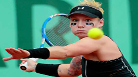 S Bethanie Mattek-Sands hits a return to Serbia's Jelena Jankovic during their Women's third round match in the French Open tennis championship at the Roland Garros stadium, on May 27, 2011, in Paris.