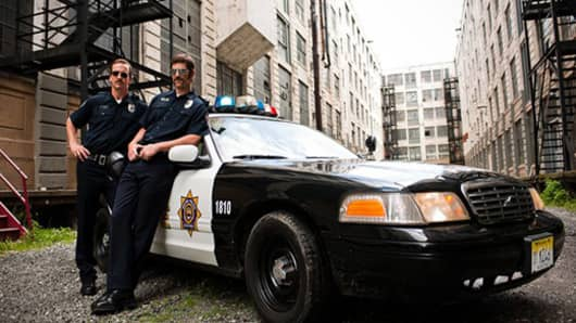 """Peyton and Eli Manning are stars of the new DirecTV viral ad campaign """"Football Cops"""""""