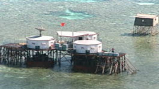 China's flag flies over octagonal structures built on stilts in the Philippine-claimed Mischief Reef in the disputed Spratly Islands located in the South China Sea.