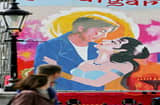 Commuters pass a giant painting of a Bollywood film poster in Trafalgar Square before heading to work on August 17, 2007 in London, England. The painting will be finished over a period of days during the Indian Festival in Trafalgar Square.