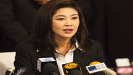 Yingluck Shinawatra, the opposition Puea Thai party candidate and sister of fugitive Thai ex-prime minister Thaksin Shinawatra, speaks during a press conference after becoming the Southeast Asian kingdom's first female prime minister.
