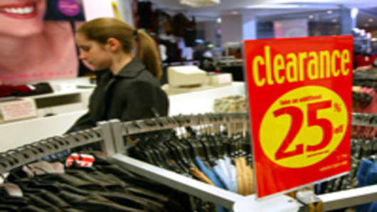 A shopper walks past a sale sign at 5 7 9 clothing store at Randhurst Shopping Center  in Mount Prospect, Illinois.