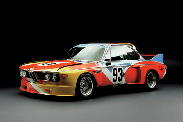 """Calder's friend, Herve Poulain, a French auctioneer and race driver, asked him to commission a rolling canvas on the BMW 3.0 CSL he would race at Le Mans 24 Hours race.An engineer and sculptor, Calder's challenge was creating his own """"artistic stamp"""" on something that he did not produce and sculpt himself. His rendition of the 3.0 CSL boasts powerful colors and attractive curving expanses, which he applied generously to the wings, hood and roof. Calder saw his art in action when he attended the"""