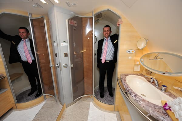 The Ilya Muromets, designed by Igor Sikorsky in Russia, was the first plane to offer passengers an onboard toilet. Today's passengers not only don't have to cross their legs on long flights, they can even take a shower and pamper themselves in first-class lavatories. At left, Andrew Parker, senior vice-present for Emirates Airlines, gives a tour from inside the shower in the first class bathroom and spa aboard an Emirates Airbus A380.