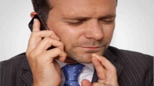 businessman_eyes_closed_fingers_crossed_200.jpg