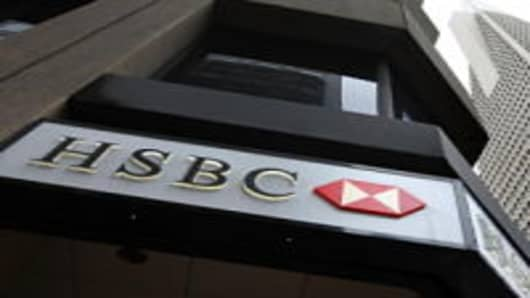 The HSBC logo is displayed on the exterior of an HSBC bank branch Ma