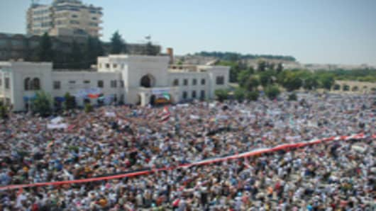 Syrians demonstrate against the government after Friday prayers in Hama on July 29, 2011