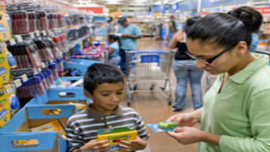 Guadalupe Orosco and her children Luis, 9 years old starting the 4th grade and David, 7 years old starting the 3rd grade shop in the school supply isles as part of back to school shopping inside a Wal-Mart store in Thornton, CO.