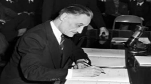 France Ambassador to the United States, Henri Bonnet, signing the Bretton Woods Agreement , 1944.