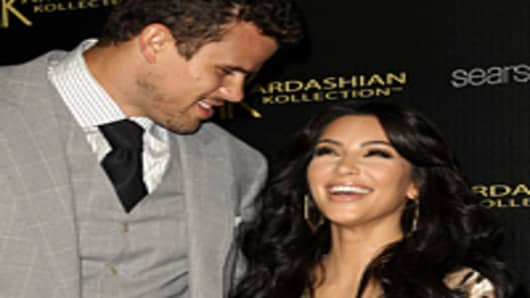 Kris Humphries and Kim Kardashian attend the Kardashian Kollection launch party at The Colony on August 17, 2011 in Hollywood, California.