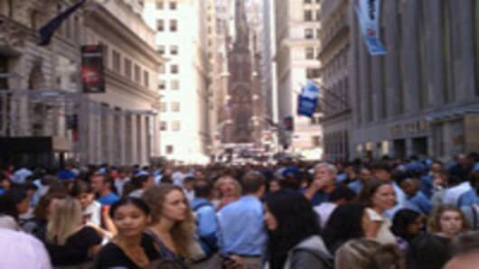 Crowds are evacuated from buildings on Wall Street in New York City after the 5.9 earthquake shook the East Coast of the United States.