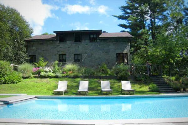 Location: Kingston, New YorkValue: $835,000Bedrooms / Baths: 4 / 3 Square Footage: 2,612Comedic performer John Leguizamo's upstate New York lakefront retreat on nearly 8 acres is an Italian crafted frame house made of cut stone. The  has cathedral ceilings, wide-plank floors, interesting architectural detailing, an in-ground pool, updated appliances, and a two-bedroom cottage for guests or a caretaker.