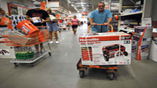 A man pushes a cart with a generator at a Home Depot store in Kitty Hawk in the North Carolina Outerbanks ahead of the expected landfall in the area of Hurricane Irene.