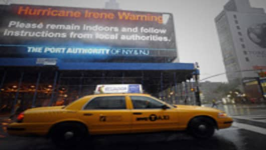 A taxi passes by a warning sign on the side of the Port Authority in New York on August 28, 2011 as Hurricane Irene hits the city and the Tri State area with rain and high winds. Irene weakened to tropical storm status Sunday as it hit New York City.