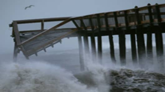Large waves from Hurricane Irene pound the Ocean City pier, on August 28, 2011 in Ocean City, Maryland.