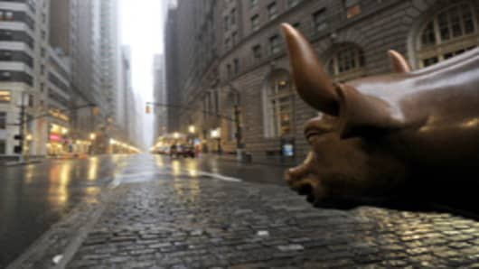 The Wall Street bronze Bull looks out to an empty Broadway in Lower Manhattan, New York, early August 28, 2011 as Hurricane Irene hits the city and Tri State area with rain and high winds.