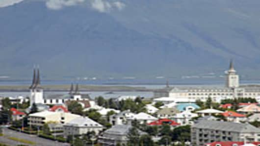 Iceland with Háteigskirkja Lutheran Church and mount Esja in distance.