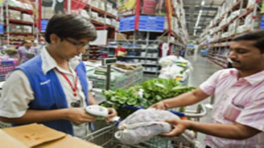 A cashier rings up a customer's groceries at a Bharti Walmart wholesale store in Zirakpur, India.