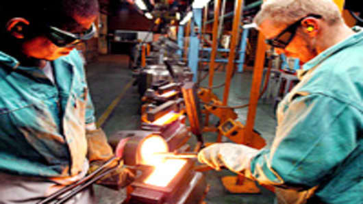 Production of gold bars is seen at the Rand Refinery in South Africa.