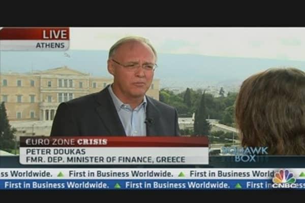 Merkel Visit Signals Commitment to Euro: CEO