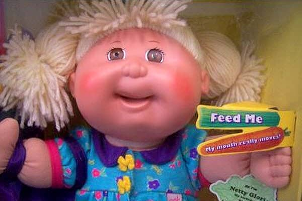 "The Cabbage Patch Kids line was introduced by Mattel at the 1983 International Toy Fair in New York City. It enjoyed blockbuster sales throughout the decade, and demand was so great that it inspired several spin-off products, such as a breakfast cereal and a diaper brand. In 1996, the Cabbage Patch Snacktime Kids line was rolled out. It came with plastic ""food"" that was hand-fed by the child into the doll's mouth, which featured a pair of one-way metal rollers behind its lips.Mattel began receiv"