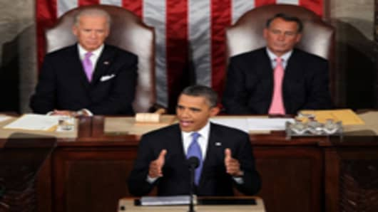 U.S. President Barack Obama, flanked by Vice President Joe Biden and Speaker of the House John Boehner, addressed both houses of the U.S. legislature to highlight his plan to create jobs for millions of out of work Americans on September 8, 2011 in Washington, DC.